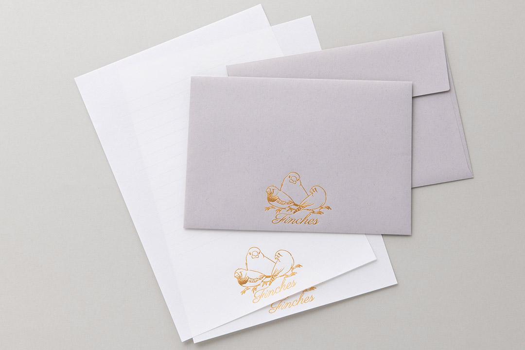 封筒の色:ライナーグレー封筒<br>箔:つや消し赤金102